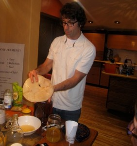 Austin handles a SCOBY during a recent kombucha workshop